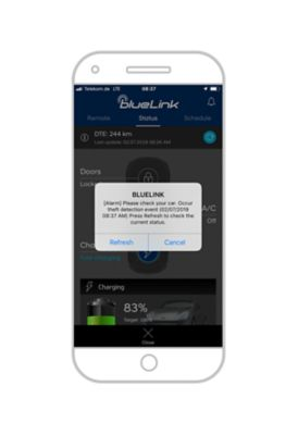 Close-up of the Hyundai Bluelink app with a theft detection push notification.