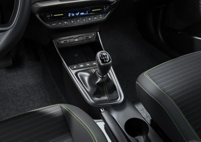 A manual transmission gear lever inside an all-new Hyundai i20, passenger side view