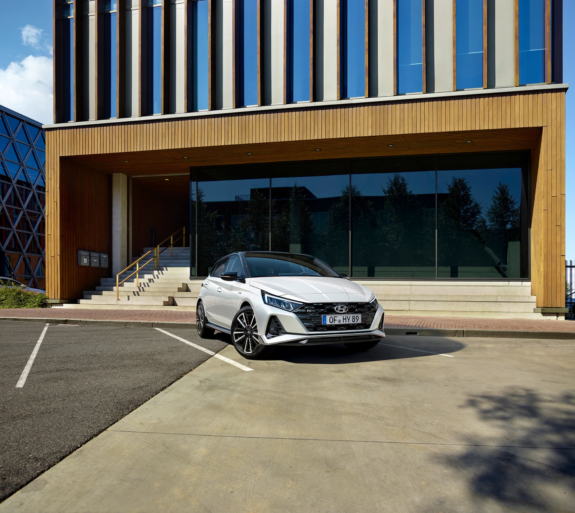 The all-new Hyundai i20 N Line in front of a building with large windows