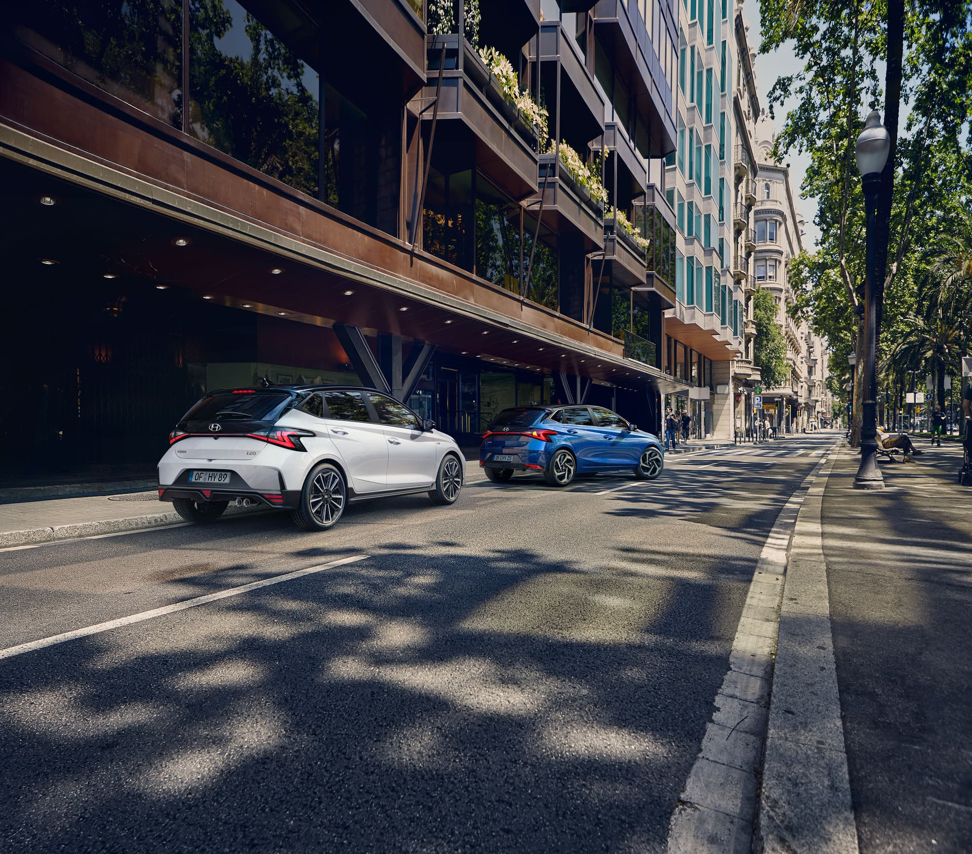 The all-new Hyundai i20 N Line parked next to large buildings in an otherwise empty street