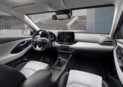 Front interior of the new Hyundai i30 Wagon as seen from the back seat