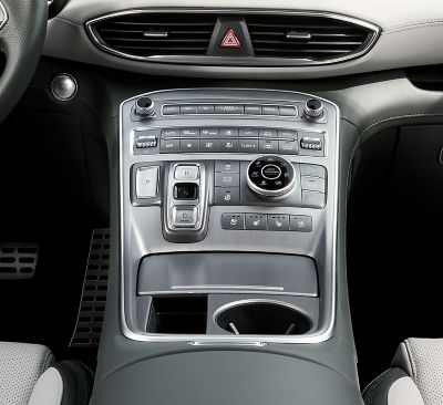 An interior view of the centre console of the new Hyundai Santa Fe Plug-in Hybrid 7 seat SUV.