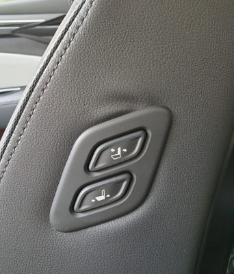 A close up image of the buttons of the Walk-in device on the passenger seat of the all-new Tucson.