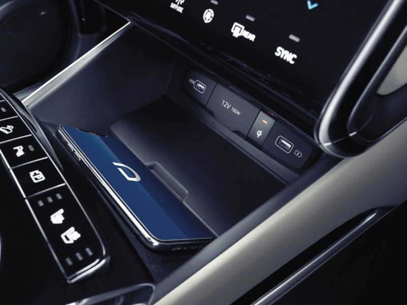 An image of the high-speed wireless charging compartment inside the all-new Hyundai Tucson SUV.