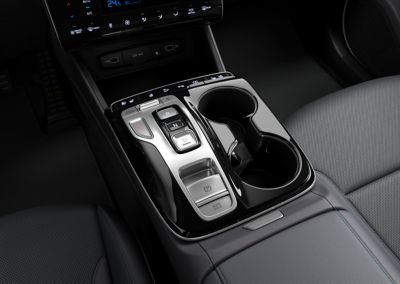 The shift by wire controls with the ergonomical arm rest in the all-new Hyundai TUCSON Plug-in Hybrid SUV.